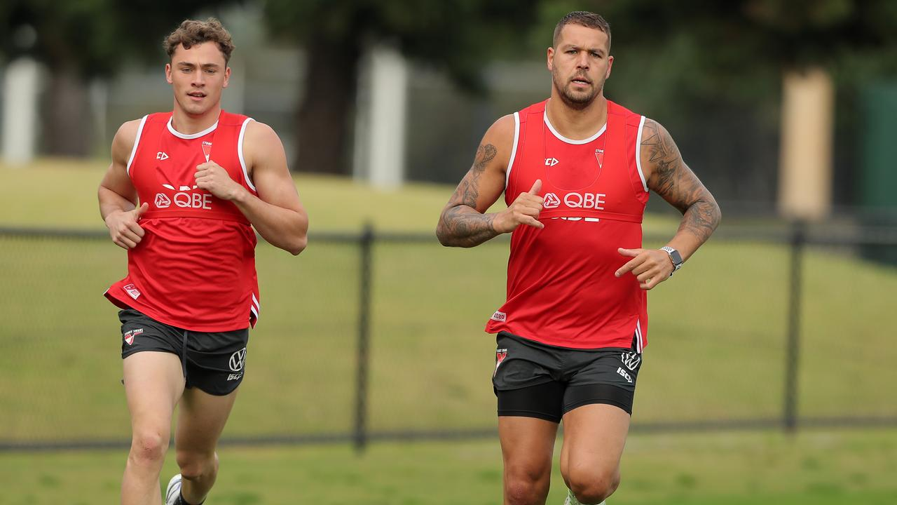 Lance Franklin runs laps with Will Hayward. Picture: Getty
