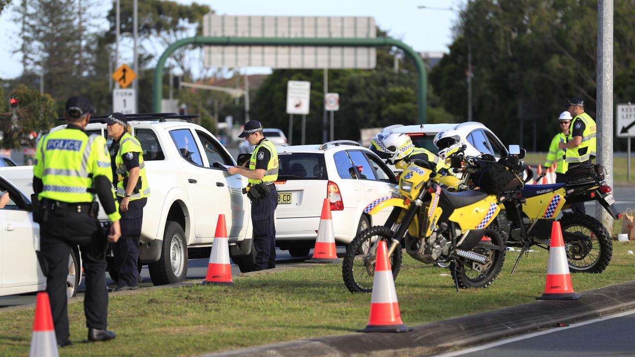 Queensland Police at the NSW / Queensland border road block at Bilinga. Photo: Scott Powick.