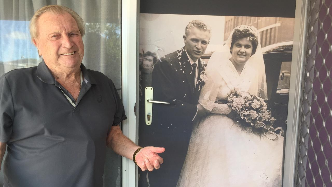 LOVE: Dennis Daines in front of his newly decorated door which shows a photo of him and his wife on their wedding day. Picture: Contributed.