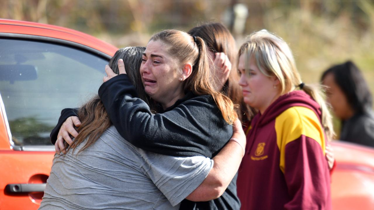 Sharon Du Bois (L) is comforted by a neighbour. Picture: Mick Tsikas/AAP