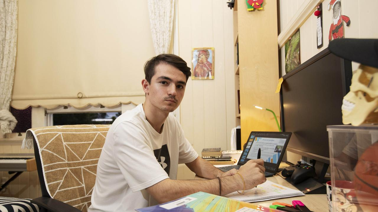 Year 12 student Tudor posing at his home in Herston. Picture: AAP/Attila Csaszar