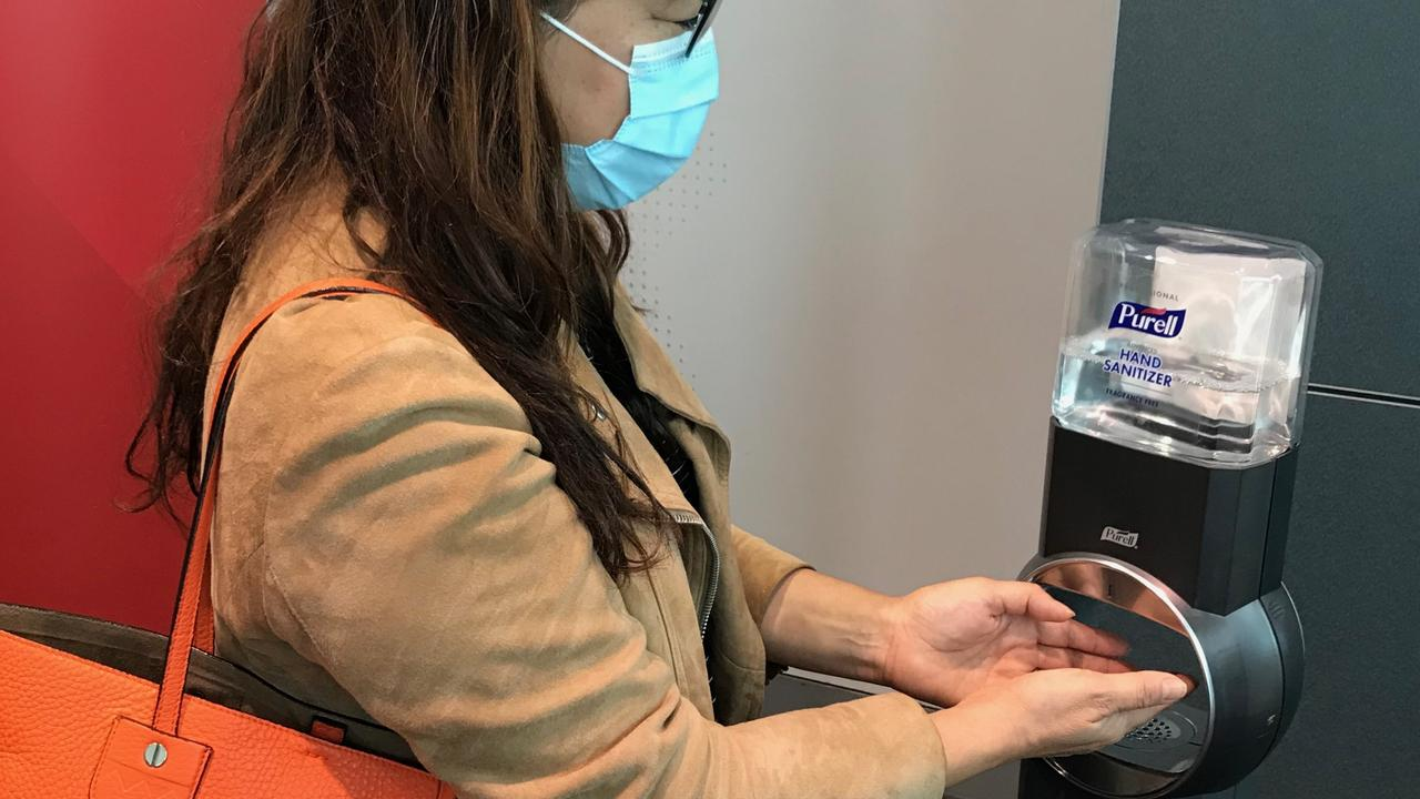 Qantas and Jetstar will provide hand sanitising stations so passengers can clean their hands before boarding a flight.