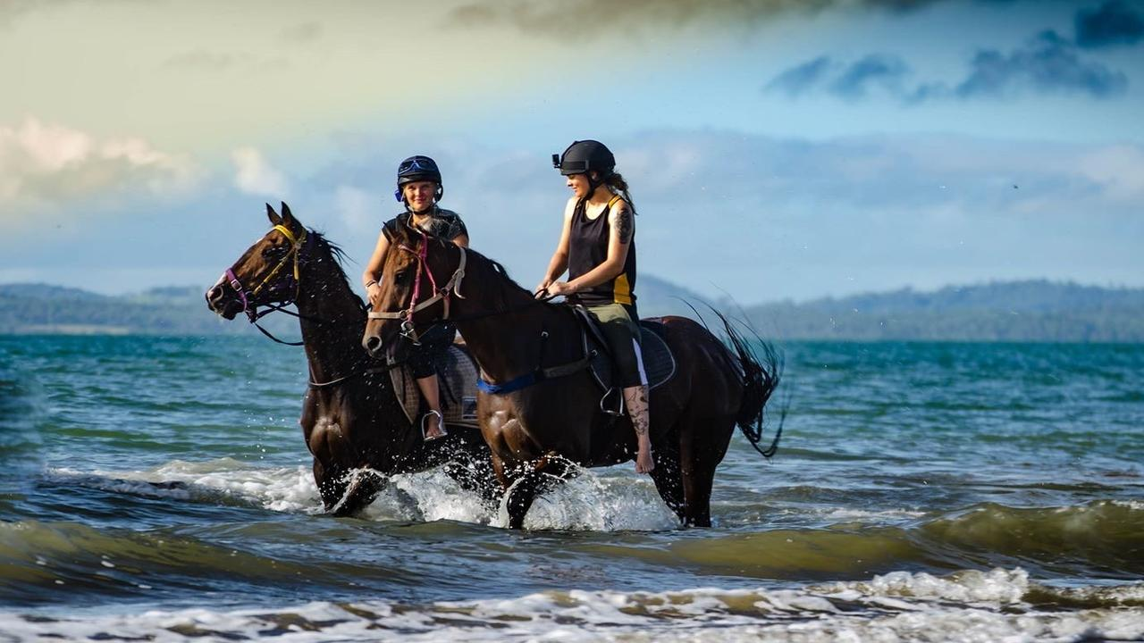 Gracious Garcon (right), being ridden by Jennifer Hatfield, had a strong start in Mackay, but suffered a few poor results soon after. Trainer Trinity Bannon said the cooler weather could be what the gelding needs to improve.