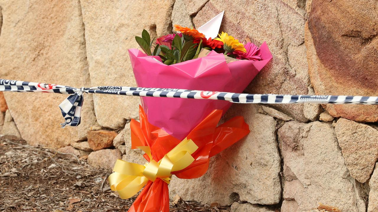 A bunch of flowers left at the scene. Picture: Liam Kidston