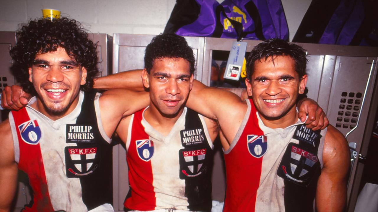 Dale Kickett, Gilbert McAdam and Nicky Winmar of the St Kilda Saints pose following an AFL match, 1990