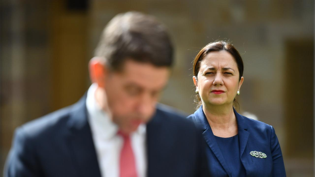 Queensland Premier Annastacia Palaszczuk (right) is seen looking on as Queensland Treasurer Cameron Dick (left) speaks about the Queensland Economic Recovery Strategy to help the state recover from the COVID-19 outbreak. Picture: AAP Image/Darren England.