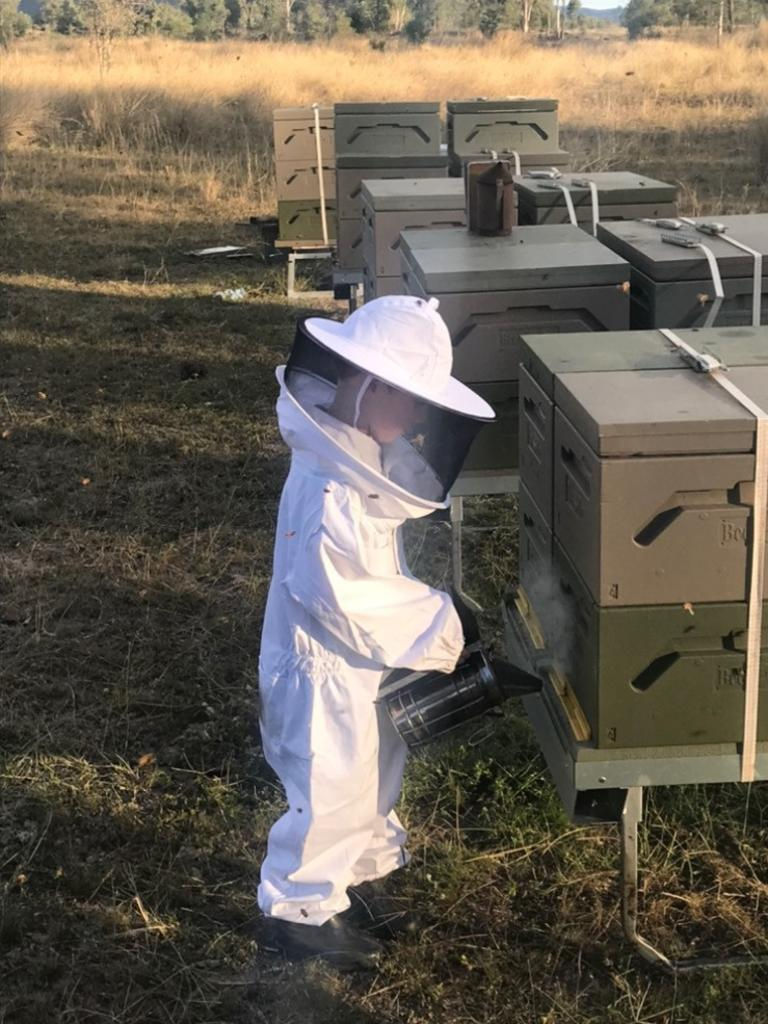 Luke McNaughton with his beekeeping suit on at the McNaughton's farm in Coalstoun Lakes. Picture: Contributed