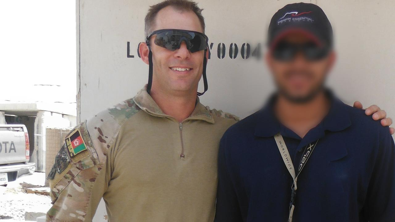 Former Army Captain Jason Scanes with his Afghan interpreter Hassan.