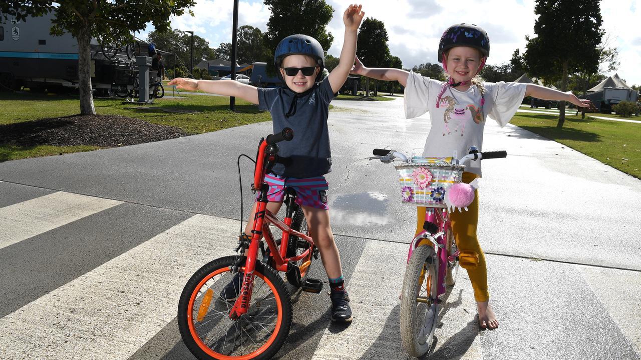 Seth Fox, 5, and Luana Fox, 7, take a ride around the park at Rivershore. Photo: Warren Lynam