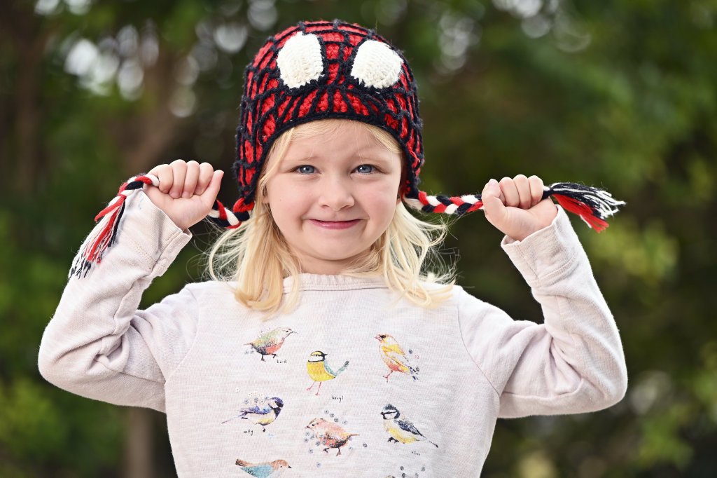 Image for sale: Claire Michelmore, 4, keeps warm on a cool Ipswich morning. Picture: Cordell Richardson