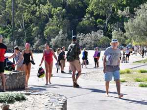 Calls to open borders as interstate tourists dream of Noosa