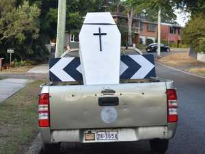 Coffin left in suburban street disgusts neighbours