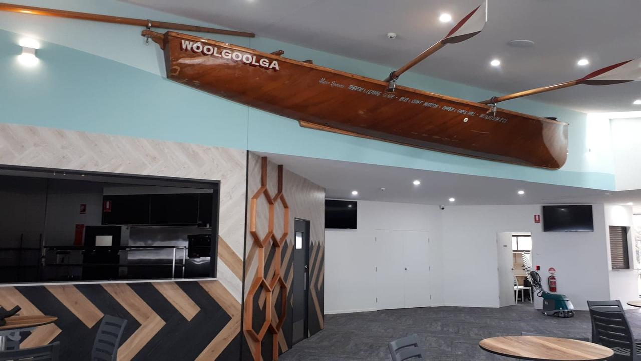 An old wooden surf boat suspended above the kitchen.