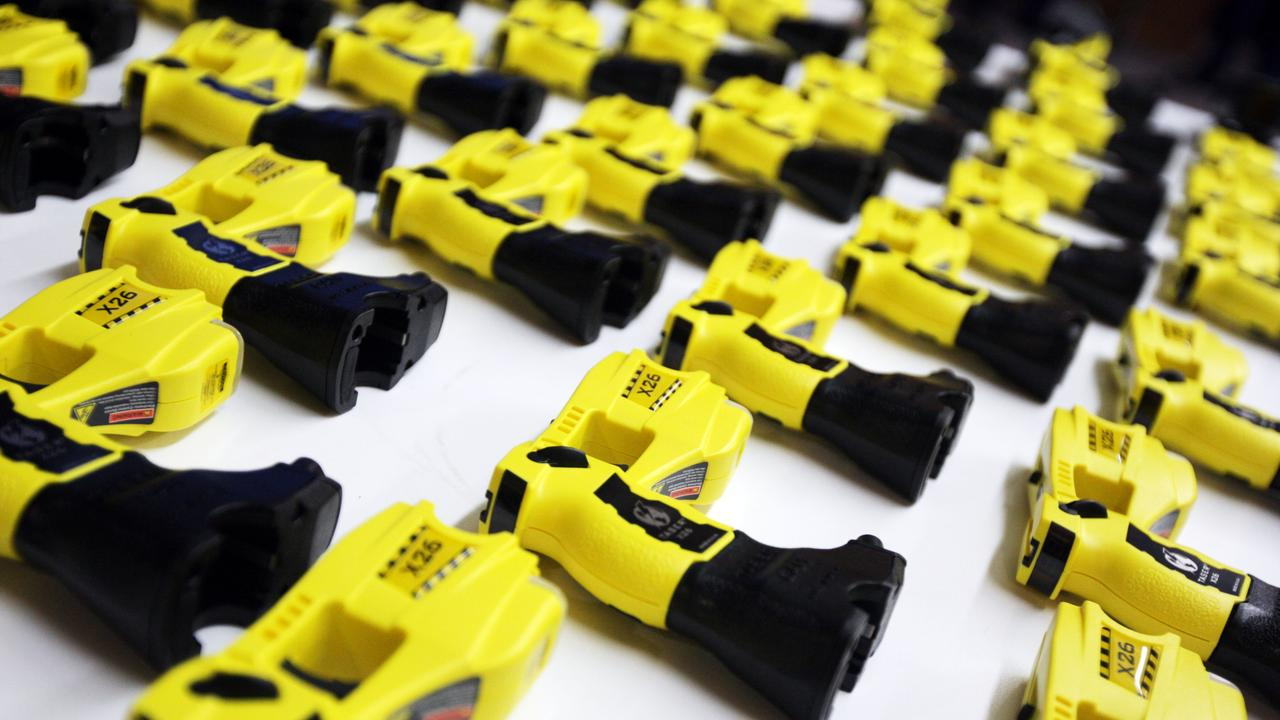 Two men had to be tasered at a party after behaving aggressively towards police.