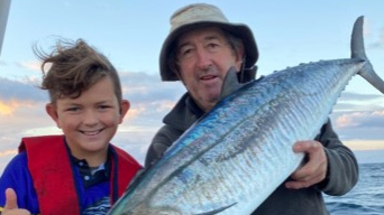 HOLY MACKEREL: If your going to catch your first Spanish mackerel, you might as well make it a good one. Ace Bell with his pop on a recent fishing trip. Picture: Graham Bell