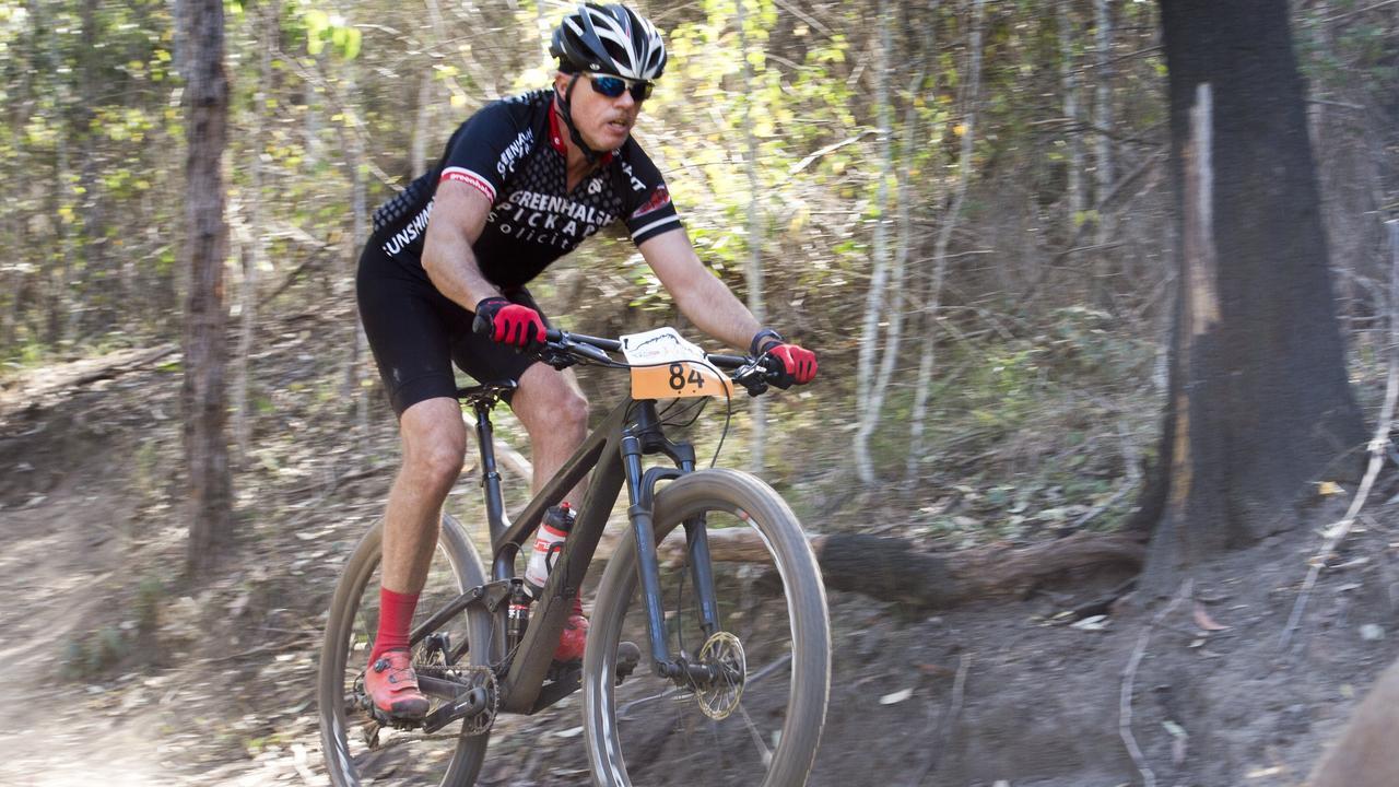 Lex Greenhalgh from the Toowoomba Mountain Bike Club rides along the escarpment.