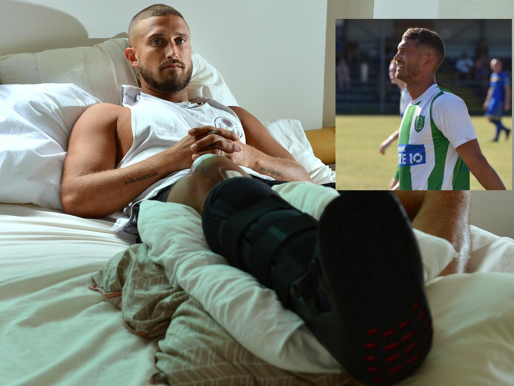 Then and now. Tim Lawson at home in bed with a broken foot more than 1000 days before he made his comeback to Coast football through Beerwah Glasshouse. Photo: John McCutcheon
