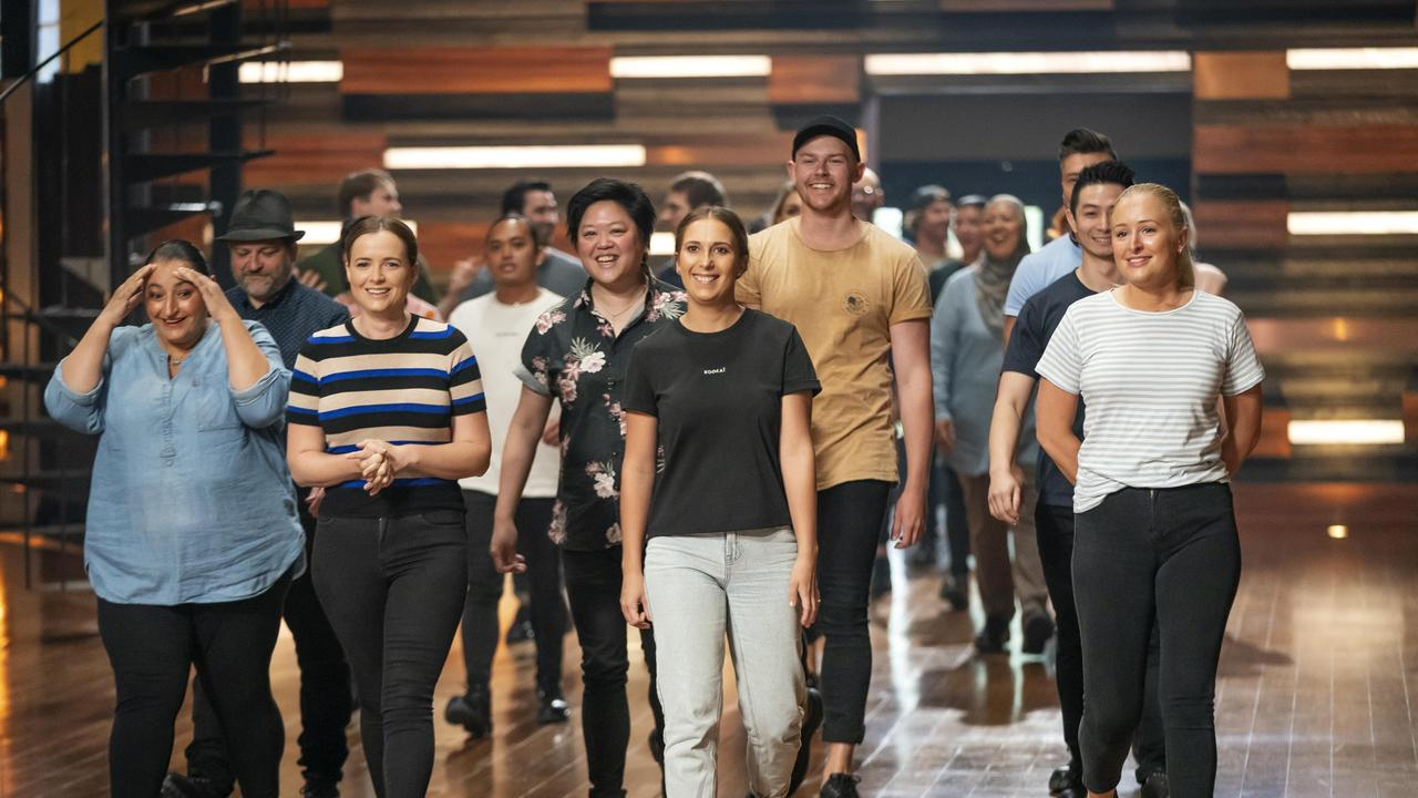 The 24 returning contestants arrive for the first day of MasterChef Australia, including Ungermann (in sky blue shirt). Picture: Tina Smigielski