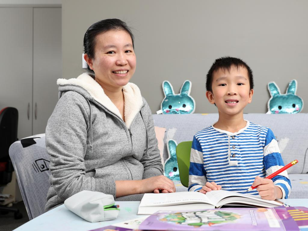 Iris Ni doing school work with her year 2 son Braydon, 7, at home in St Ives. Picture: Jonathan Ng