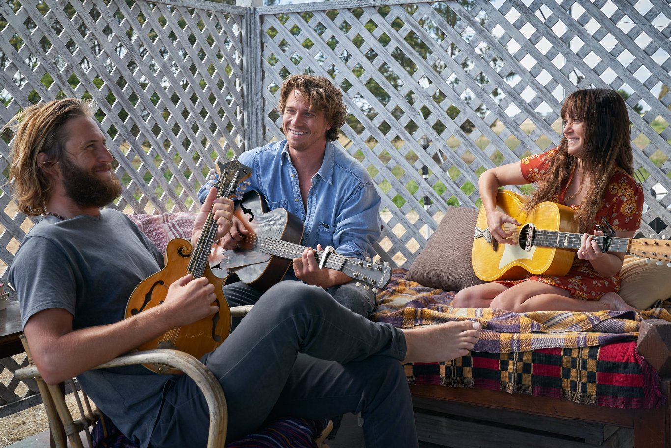 George Mason, Garrett Hedlund and Julia Stone in a scene from Dirt Music.
