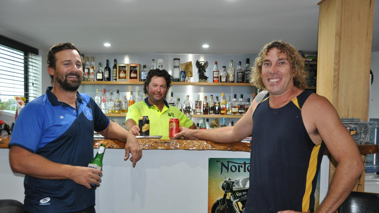 New Yeppoon Podcast legends Jay Stafford and Luke Hinton at the bar with Ghost (Andrew Mearns)