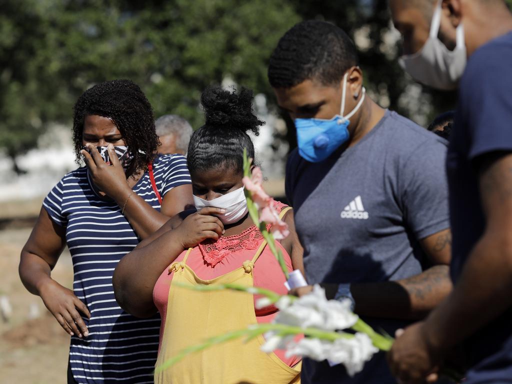 Relatives attend a burial in Rio de Janeiro, Brazil, where cases of coronavirus are rising. Picture: AP Photo/Silvia Izquierdo