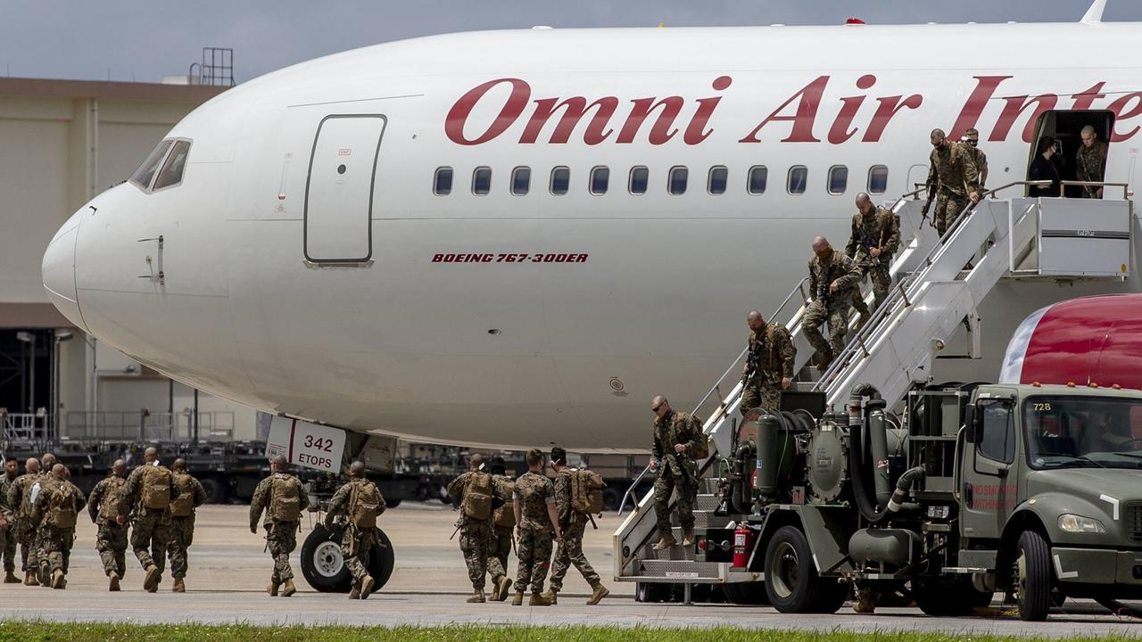 Marines disembarking from a flight in Okinawa, Japan, where they will undergo 14 days of quarantine before making they make their way to Darwin. Picture: MRF-D, Twitter.