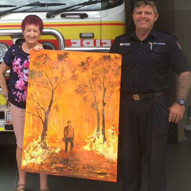 Artist Pam Withers with Justin Groth from Gympie Station presenting her bushfire inspired artwork.