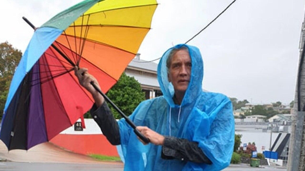 Gympie Times journalist Arthur Gorrie braves a rainier day.
