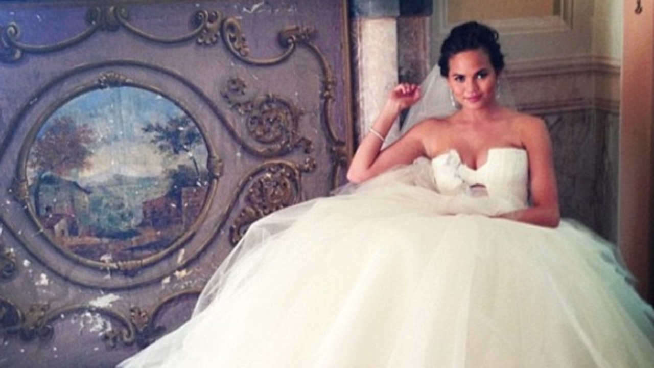 Christy Teigen bought five wedding dresses after feeling 'guilty' for trying them on. Picture: Supplied