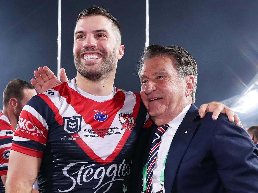 Nick Politis celebrates with Rooster star James Tedesco.