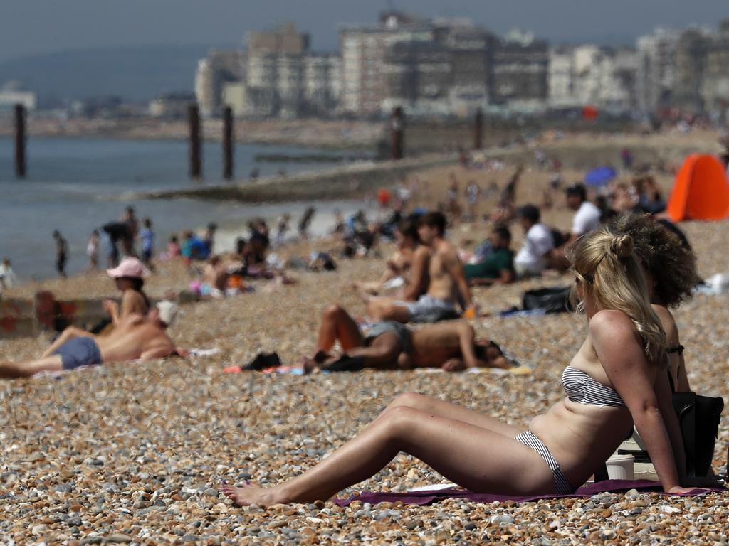 People sunbathe on a beach in Brighton, England. Lockdown restrictions have been relaxed allowing unlimited outdoor exercise and activities such as sunbathing. Picture: AP Photo