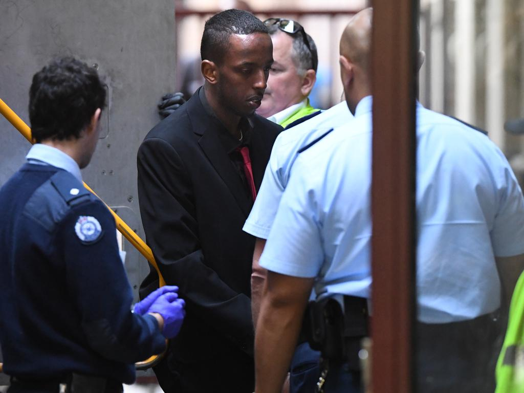Ali Khalif Shire Ali (second from left) arrives at the Supreme Court of Victoria in Melbourne. Picture: Julian Smith/AAP