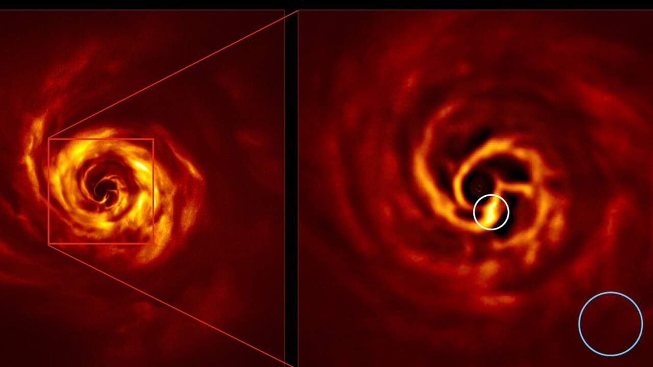 The image on the right is a zoomed-in version of the area indicated by a red square on the image on the left. The very-bright-yellow twist (circled in white) marks the spot where scientists believe a planet is forming. Picture: ESO/Boccaletti et al