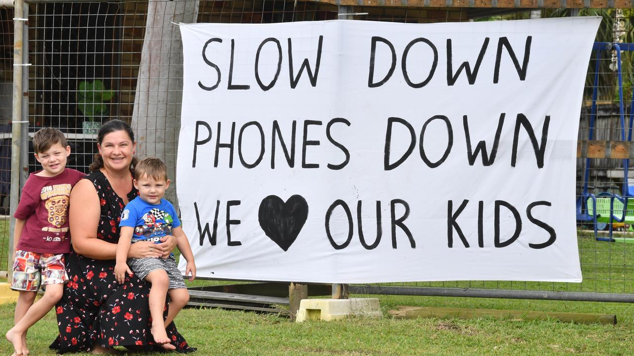 Palmina Rae with son Zavier and Amais have placed a special sign where their fence was hit by a speeding car.