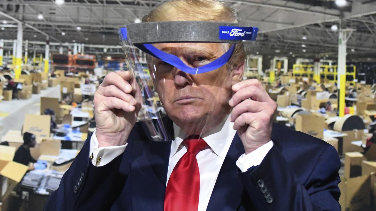 Mr Trump did, apparently, agree to pose with this face shield, which is one of the PPE items being manufactured at the plant. He's not wearing it, but he is holding it up to his face, for some reason? Yeah. Picture: Daniel Mears/Detroit News via AP