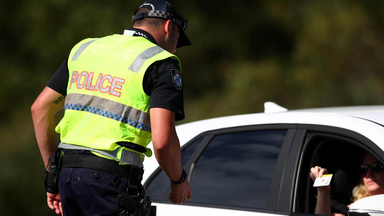 Queensland Police check a car at the border.
