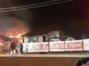 Smoke blankets suburb as fireys battle house blaze