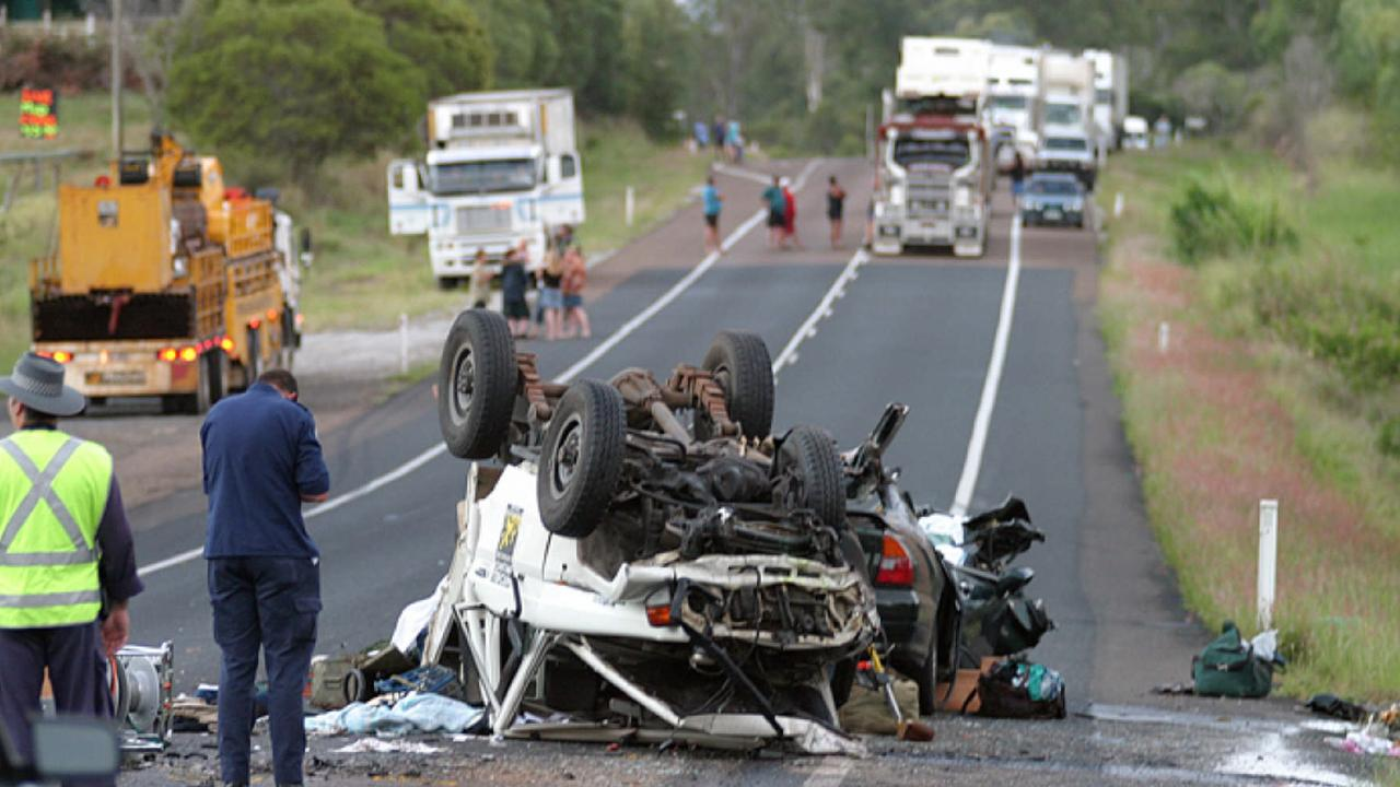 07 May 2005 Road closed at scene of a fatal head-on collision between a Mitsubishi sedan and LandCruiser utility, on the Bruce Highway at Bells Bridge, north of Gympie, in which a man 53yrs died and three people were injured. accidents qld cars fatality police investigator wreckage