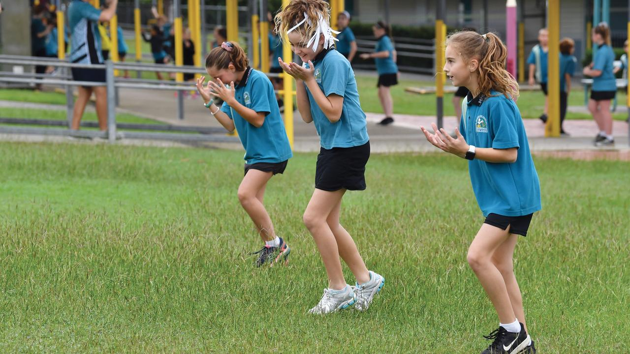 FLASH MOB FUN: Beaconsfield State School year 6 students Isabelle Hill, Lila Munt and Lily Spencer flash dance at their school together with schools across the Mackay region. Picture: Tony Martin