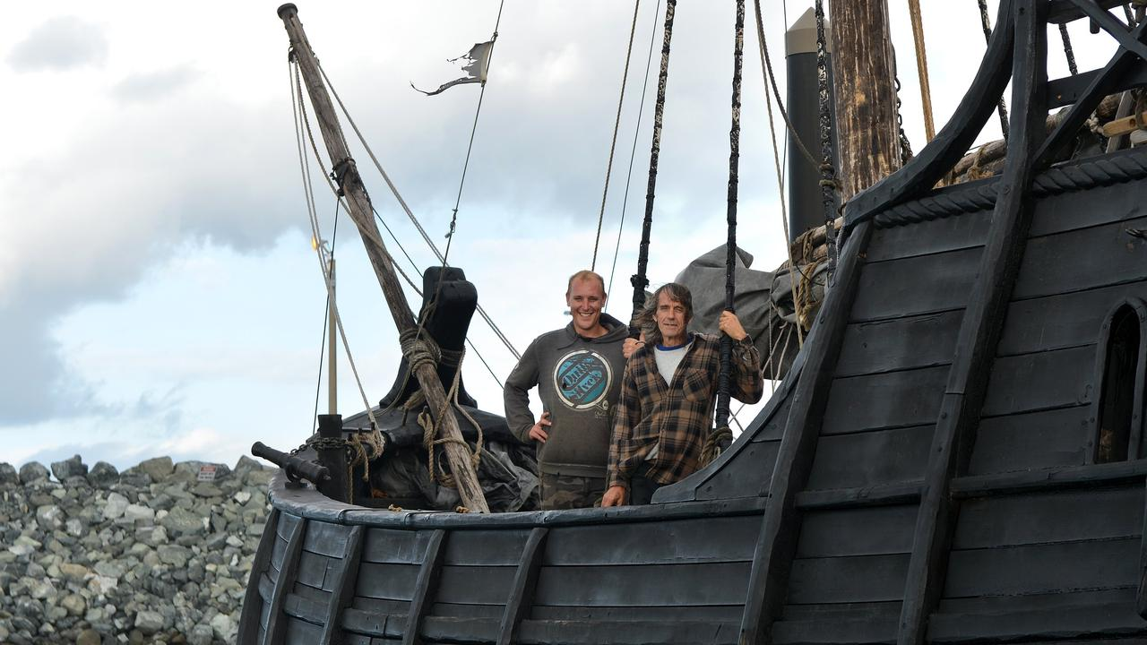 A-HOY THERE: The Wylies on their 15th century Caravel 'Notorious', hand-built by Graeme which is currently docked at The Mackay Marina. Picture: Lee Constable