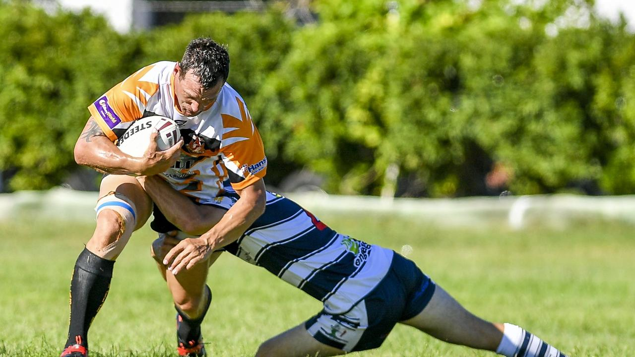 Wallaby's Jason Batchelor is tackled by Gladstone Brothers. PICTURE: Matt Taylor
