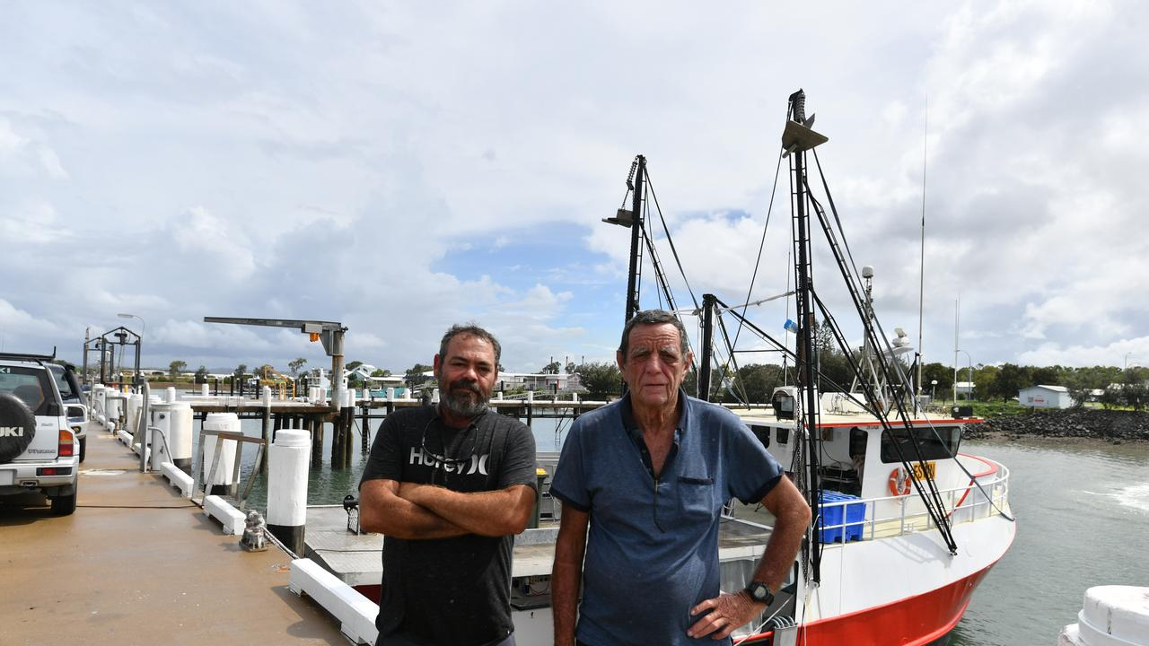 Commercial fisherman Gary Grant with son Michael at the Gladstone wharf