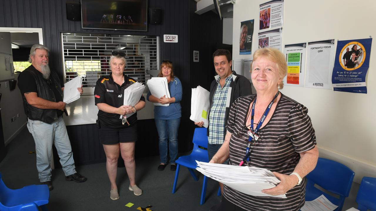 Ipswich State High School Care Army are delivering student work packages to their homes. Group leader Debbie Hudson (right) with (from left) Peter Ackerley, Myf Pitcher, Kylie Horsfall and Peter Johnstone.