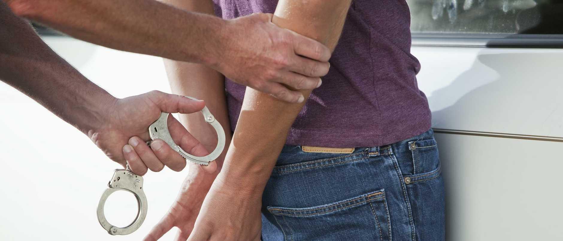 Teenager being handcuffed