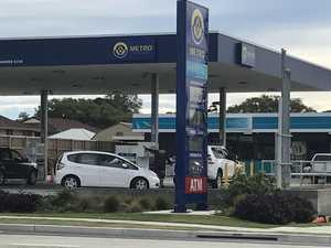 Service station employee threatened with knife during holdup