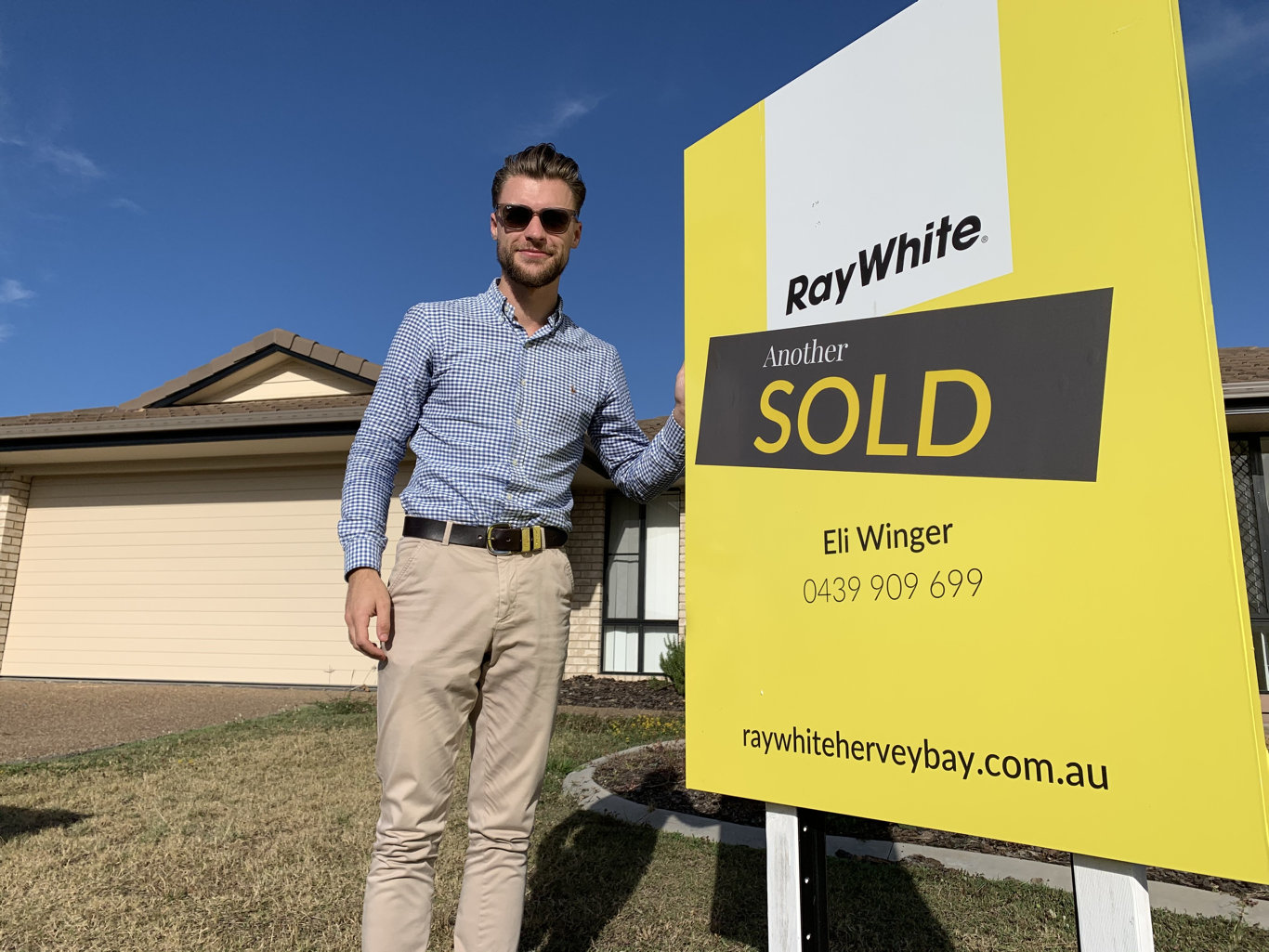 Ray White Hervey Bay sales and marketing consultant Eli Winger outside the home he sold in just two days. PHOTO: Contributed.