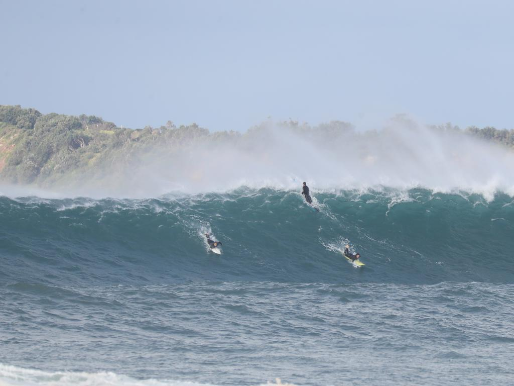 At North Narrabeen some surfers were being towed out to catch the huge waves. Picture John Grainger