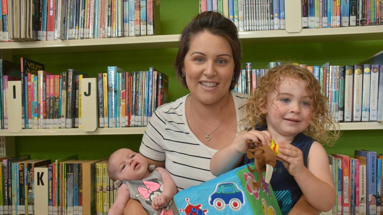 HOORAY: Book enthusiasts like Ellie Major and little Splenda and Banx can now get their hands on some new books at the Kingaroy library after Mayor Otto announced all South Burnett sercive centres and libraries will be reopening as of Monday. Picture: Jessica McGrath.