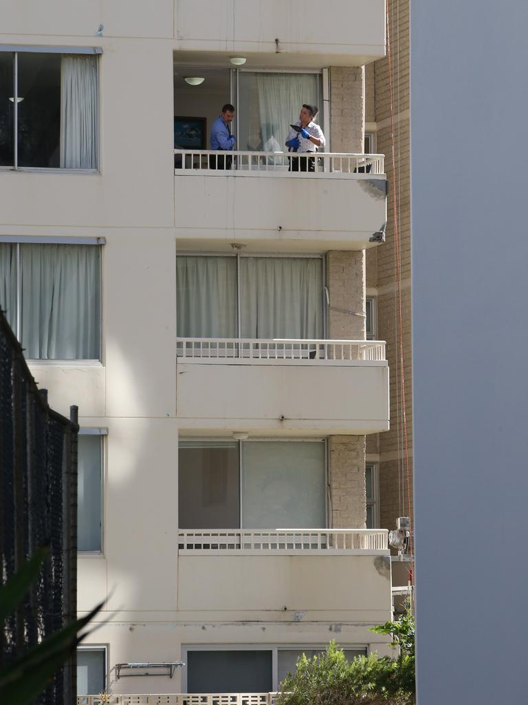 Police on a balcony of the View Pacific Resort as they investigate the alleged murder. Picture: Glenn Hampson